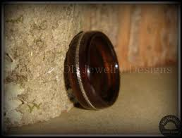 jewelry wooden rings images Handmade macassar ebony wood ring with silver guitar string inlay jpg