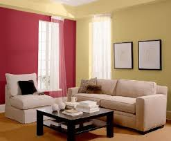 decorating colors around a dark olive green velvet couch