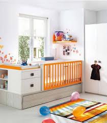 nursery room rug wicker baskets oak laminate change dresser baby