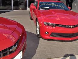 victory red next to red at dealer ship camaro5 chevy camaro