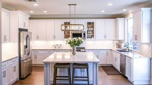 how to paint stained kitchen cabinets painted vs stained kitchen cabinets which is right for you