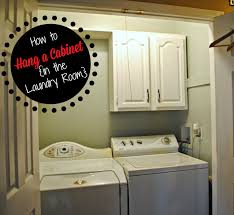 two it yourself turn a thrifted cabinet into laundry room storage