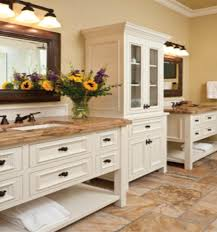 white wooden cabinet with drawers and brown granite bathroom