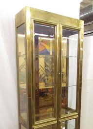 hollywood regency lighted display cabinet or vitrine in brass by