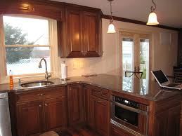 kitchen cabinet with sink pros or cons to bump out at sink
