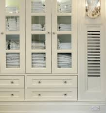 white linen cabinet with doors glass front linen cabinet traditional entrance foyer sussan