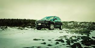 green jeep cherokee 2014 2014 jeep cherokee limited 4x4 review oddly charming or