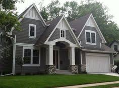 really dark grey siding with white trim and black roof a house