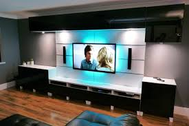 wall mounted wide screen tv above white stained wooden floating