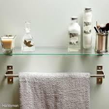 clever and useful bathroom storage tips family handyman hang a shelf over your towel bar