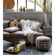 living room inspiration layers of pillows with throw and pouf