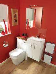 white toilet and laminate flooring mirror also wooden chair red