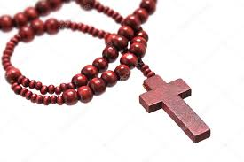 rosary with cross made of wood isolated on a white