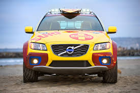 yellow jeep on beach quick response team delivers new concept for beach pros volvo