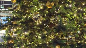 a tree decorated with sparkly gold bowknot