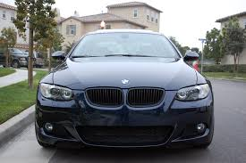 bmw black grill torn between chrome and gloss black grills