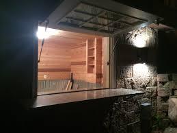 granite bar with flip up boat house window boathouse design