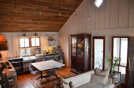 dining room great room with log cabin and open floor plan with