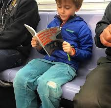 Kid On Phone Meme - when your kid finally starts reading a book on subway rides instead