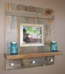 reclaimed barnwood shelf with antique hooks for the home
