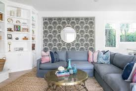 coastal living room with seashell wallpaper accent wall 50008