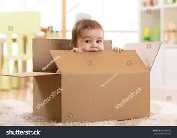 pretty baby infant boy sitting inside stock photo 624300332