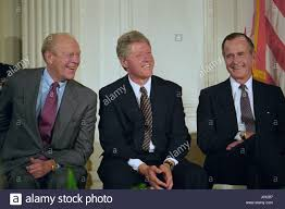 u s president bill clinton shares a laugh with former presidents