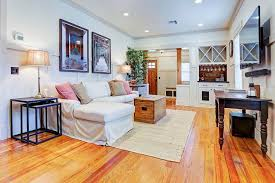 cottage living room with hardwood floors crown molding in