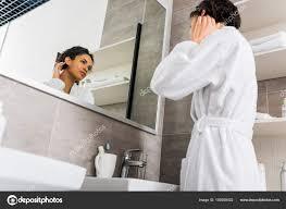 how to clean mirrors in bathroom beautiful african american girl looking her clean skin mirror