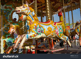 colourful traditional fairground carousel stock photo