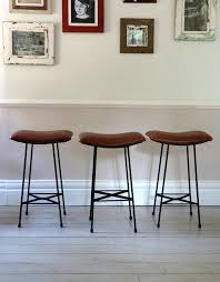 set of three 1960s industrial leather counter stools ormston