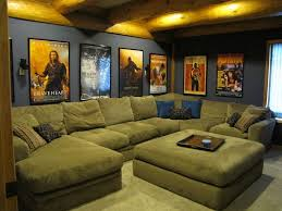 home theater room with a big couch and our movie posters on the