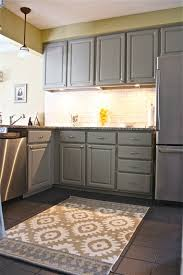 mid gray cabinets with light yellow walls and accents white
