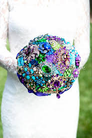 peacock wedding theme gold teal blue peacock bridal broach bouquet whimsical wedding theme