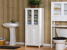 White Bathroom Laminate Flooring - white wooden cabinet with glass door with white washstand and