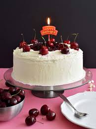 white chocolate cake with cherry sauce pepper delight
