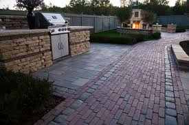 Unilock Patio Designs by Unilock Fireplace Outdoor Kitchen Patio Walkway Wall