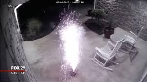 security camera shows man setting off fireworks on front porch of