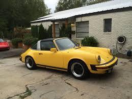 yellow porsche 911 targa