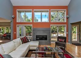 modern grey living room fireplace with orange wall accent color