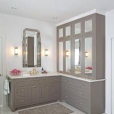 Bathrooms With White Cabinets Gray Bathroom Vanity With Mirrored Cabinets And Brass Urchin