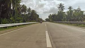 philippines motorcycle taxi village road motion on motorbike philippines bohol island stock
