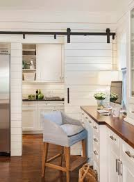 bringing sliding barn doors inside view in gallery kitchen office divided by a small barn door