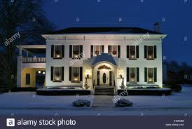 house white house at dusk with candles wreaths in the