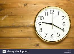 wall clock on the wooden wall at time 9am or 9pm stock photo