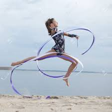 outdoor ribbon professional gymnast woman with ribbon outdoor
