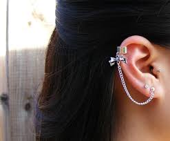 earrings with chain ear cartilage image of small bow cuff and chain earring 10 00 i m so obsessed