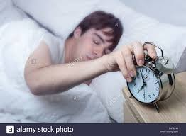 Old Fashioned Alarm Clocks Close Up Of An Old Fashioned Alarm Clock Young Man Turning It Off