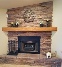 endurathane faux wood beam used as shelf on mantel architectural