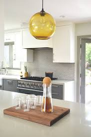 yellow modern kitchen amber colored glass complements yellow accents in california kitchen